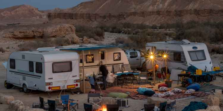 RVs circled at a group campground in the desert