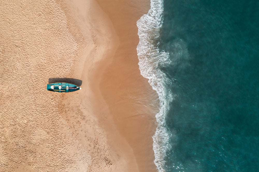 Aerial view of Cape May with a life guard boat on the beach.
