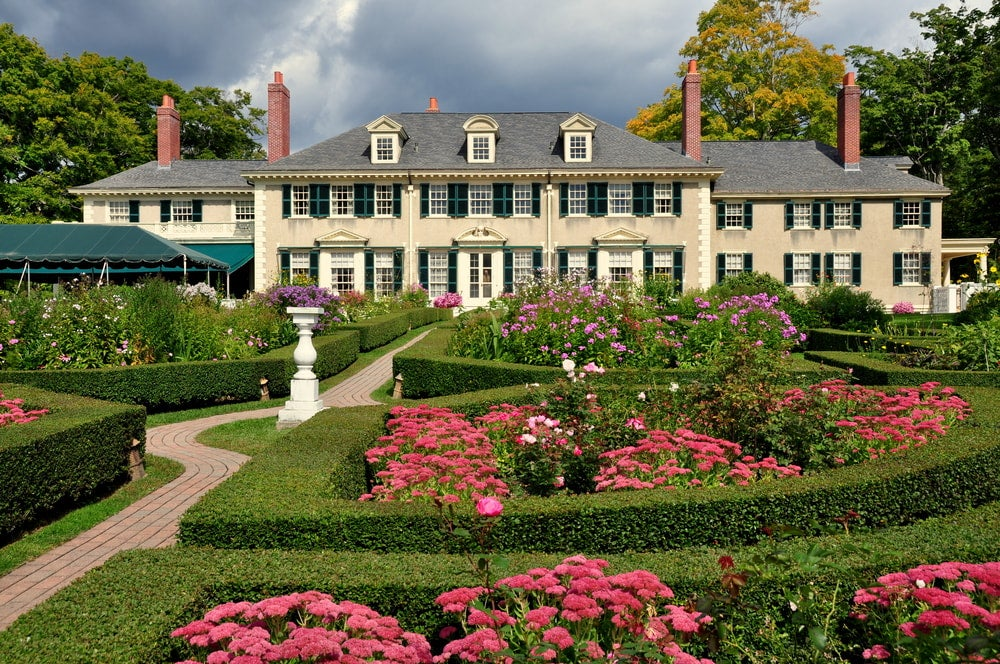 Pink flowers and gardens surround the Hildene estate house