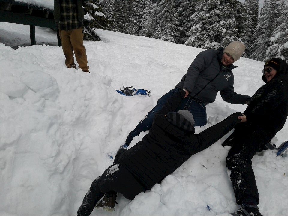 Teens practicing snow safety tactics.