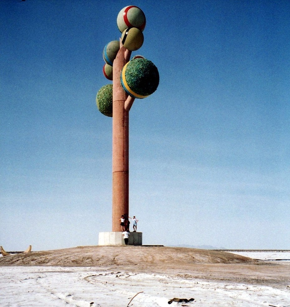 Art installation of tree with green spheres on top