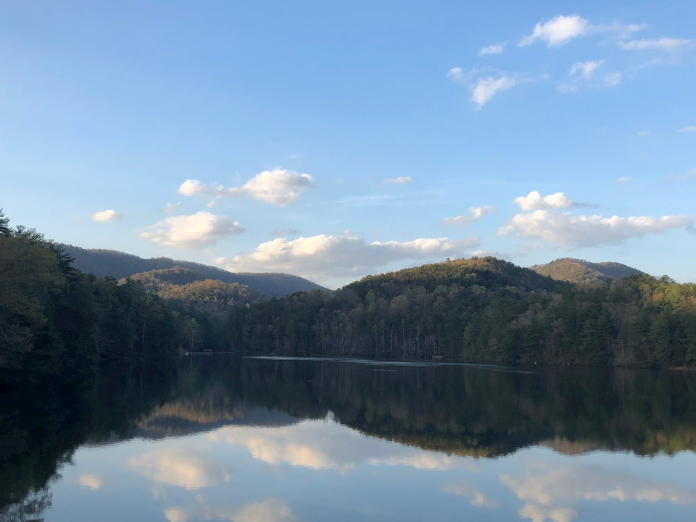 Panoramic view of rolling hills and lake