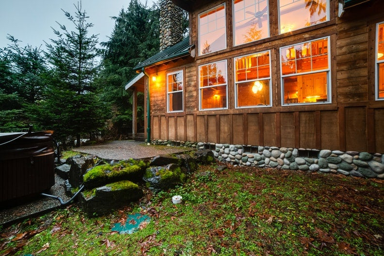 a large family cabin on mount baker with a river rock chimney