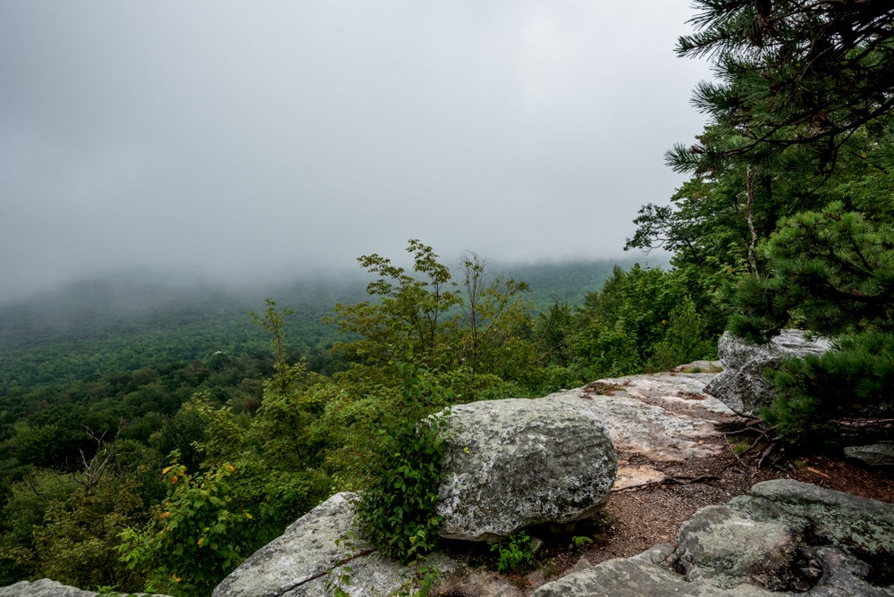 Fog covered viewpoint on a rocky precipice in the Catskills.