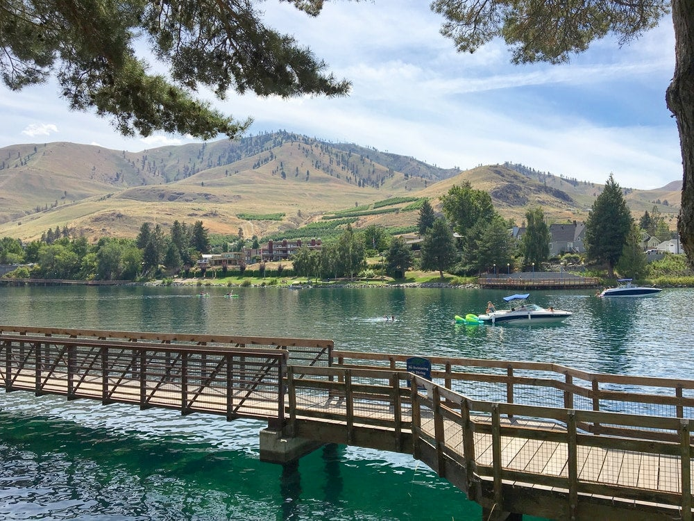 River walk along Lake Chelan, WA with boats in the background.