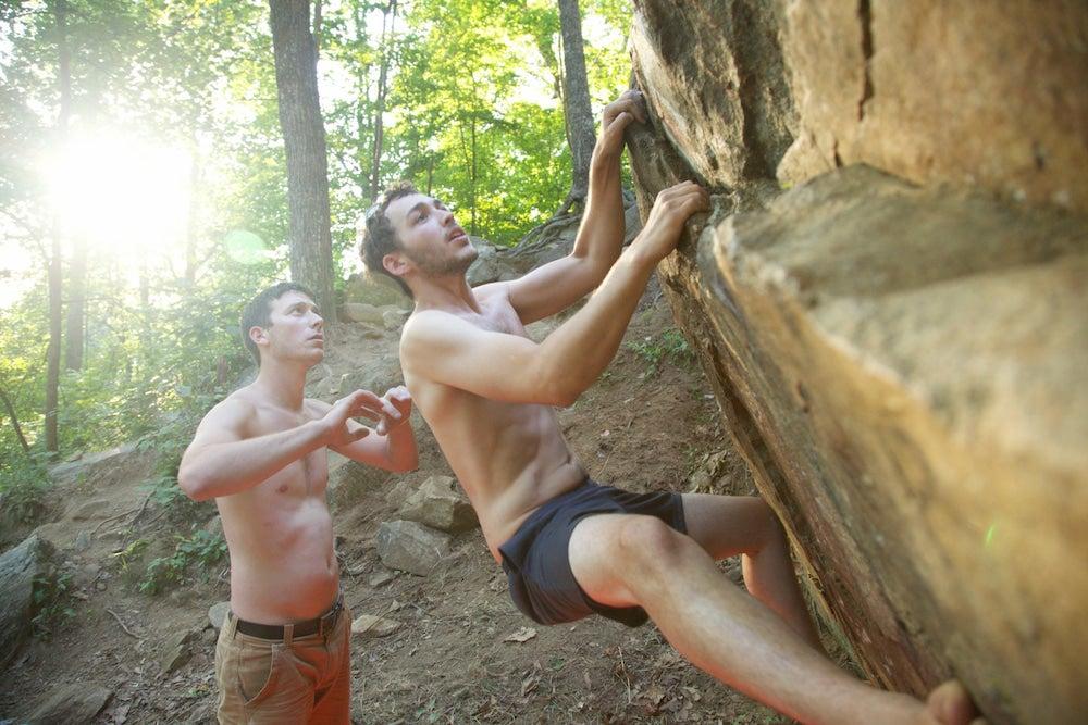 Two men bouldering