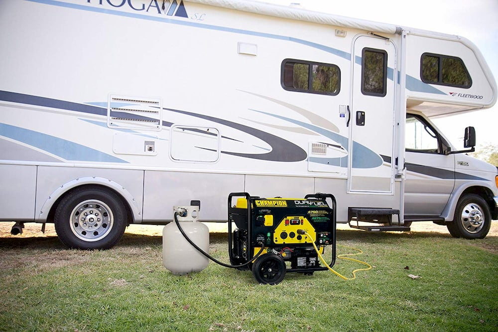 a camping generator in front of an RV camper in a field