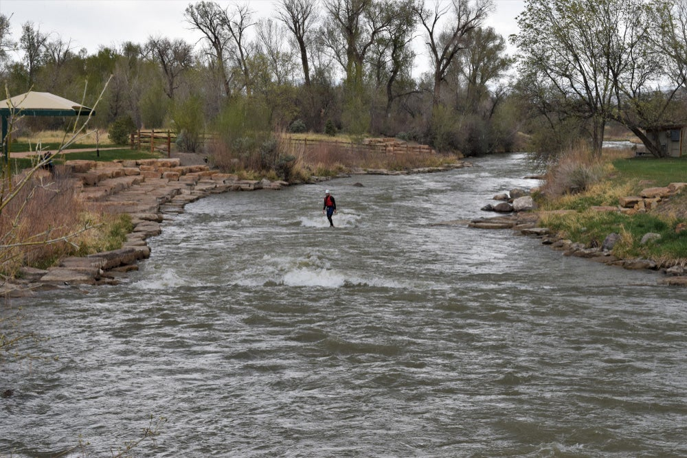 River surfer riding a small break in Colorado.