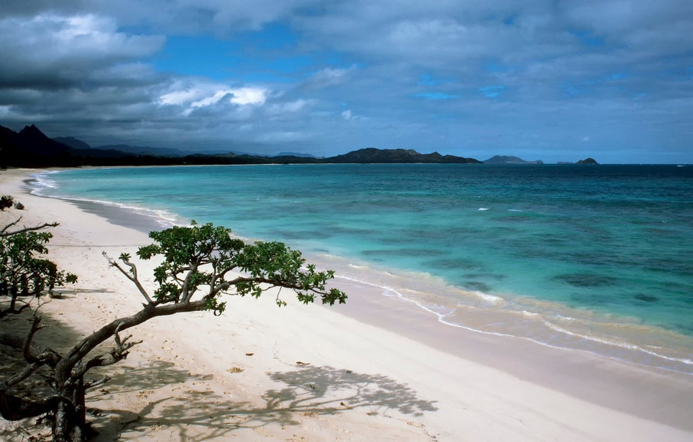 Oahu beach with white sand and bright blue water.