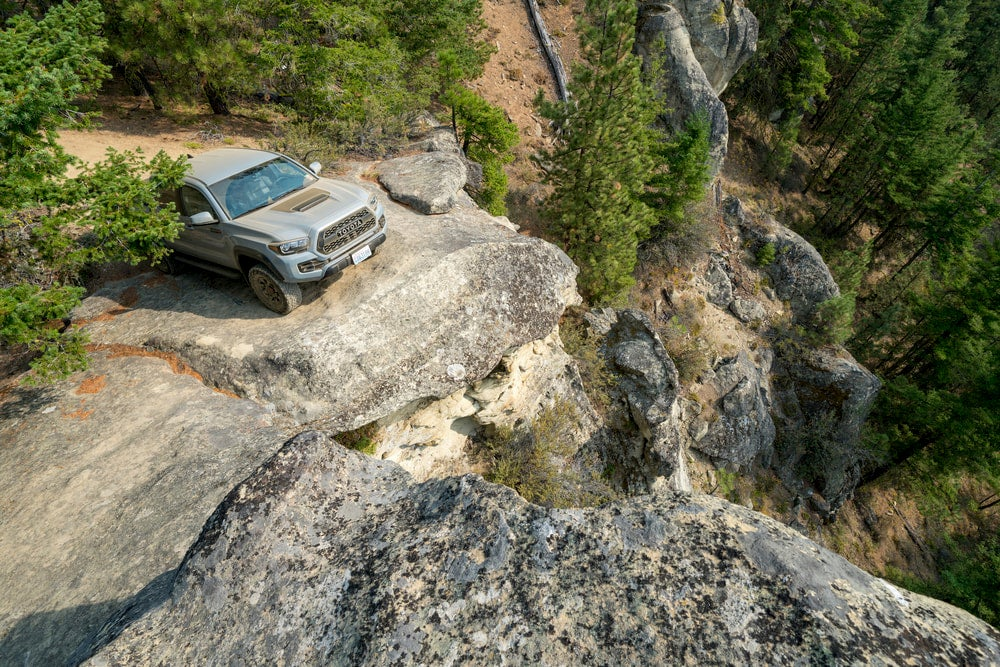 Toyota tacoma at the edge of a cliff.