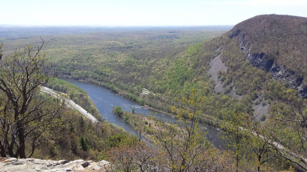 an overlook on the delaware river in pennsylvania from a high mountain