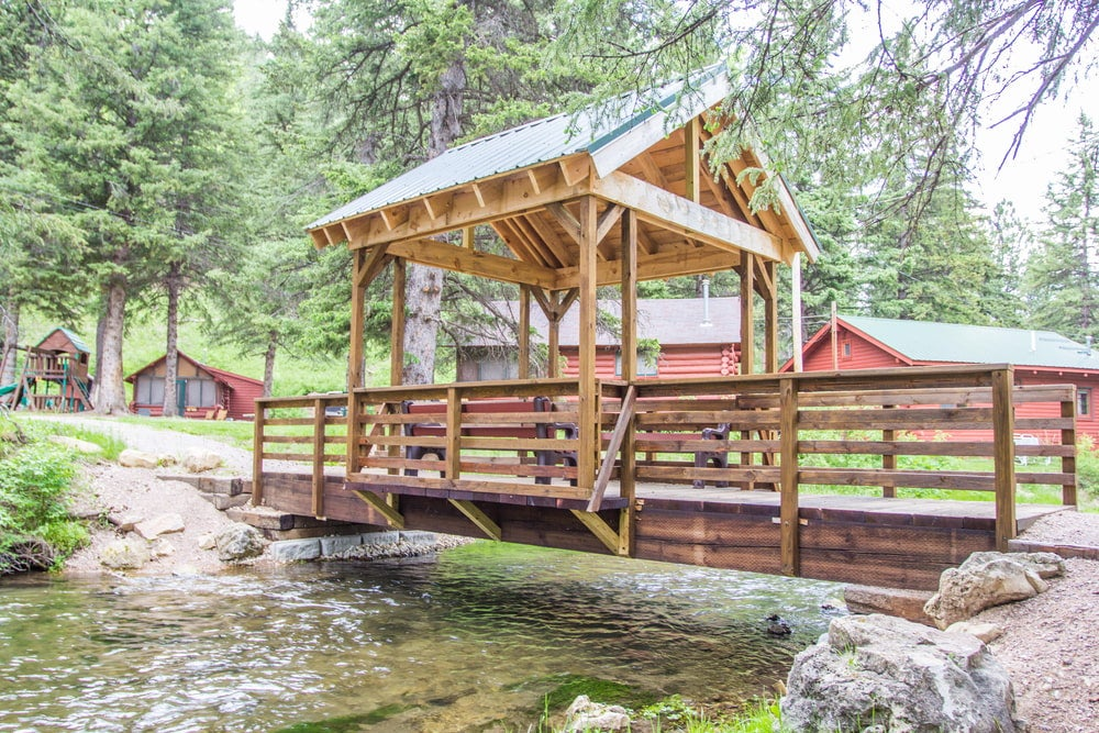 covered bridge over small river on the wickiup village property
