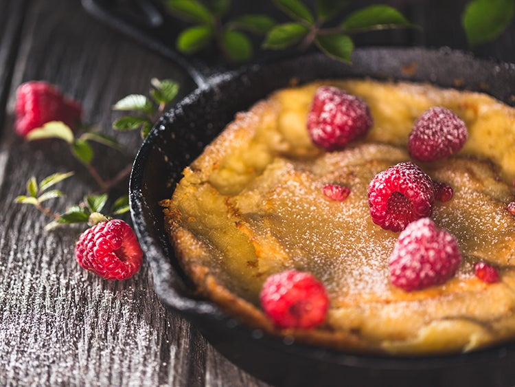 close up of raspberry dessert in a cast iron skillet