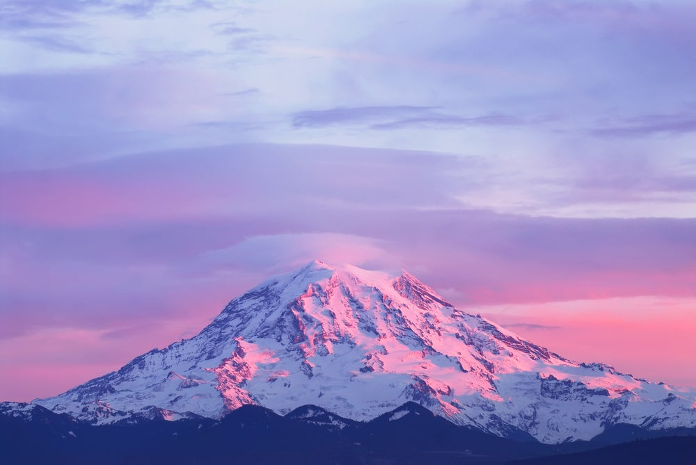 mount rainier with a pink sunset on it