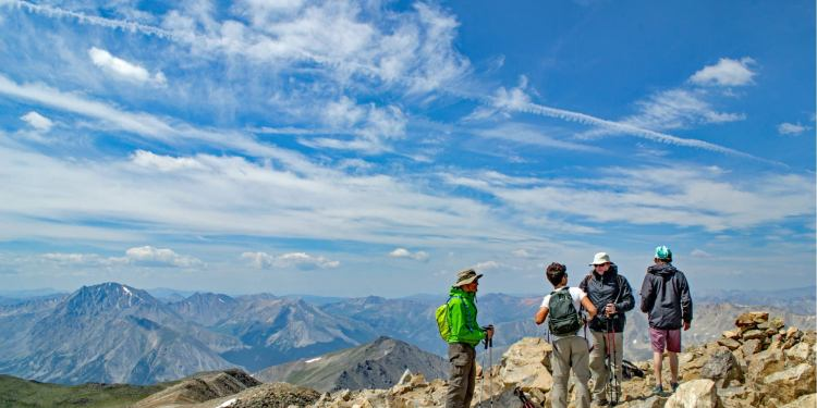 a group of hikers on the summit of mt elbert in colorado