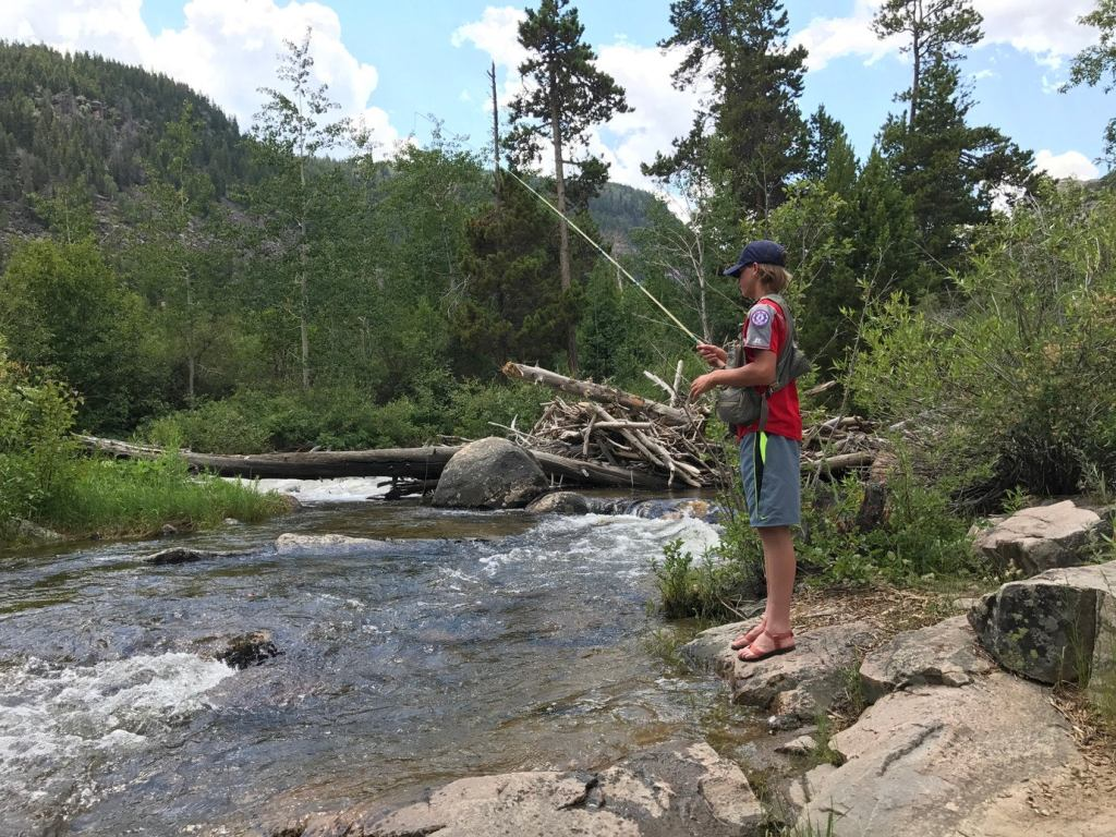 a teenager fishing in the popo agie river in wyoming