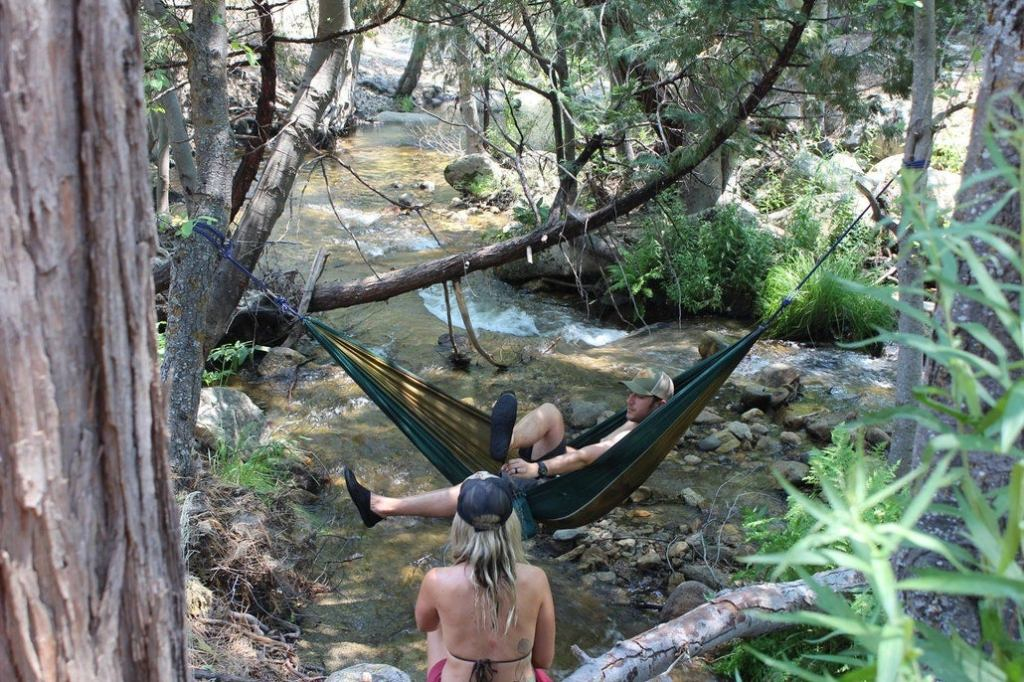 a person hanging in a Hammock over the kern river