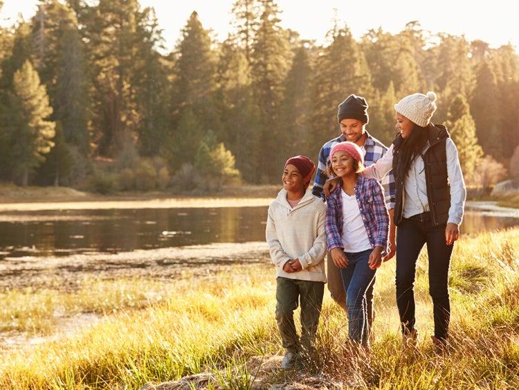 family hiking near lake