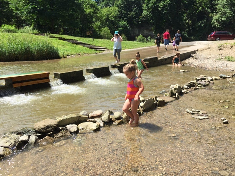 children wade in shallow water at Ledges State Park in Iowa, photo from a camper on The Dyrt