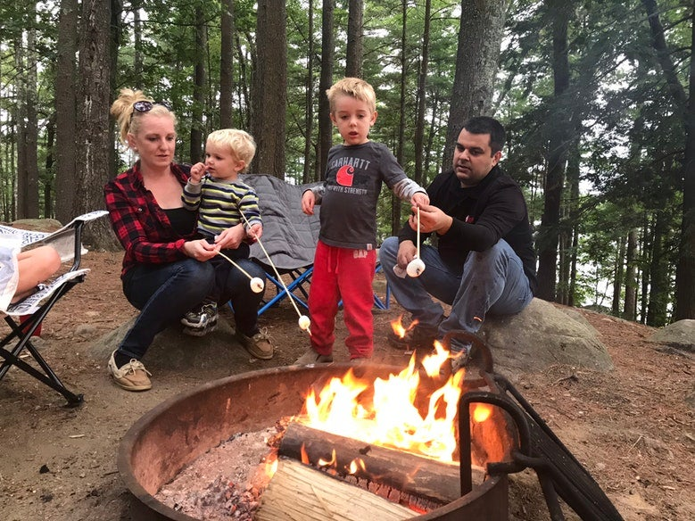 family of four roasts marshmallows at Pawtuckaway State Park campsite, photo from a camper on The Dyrt