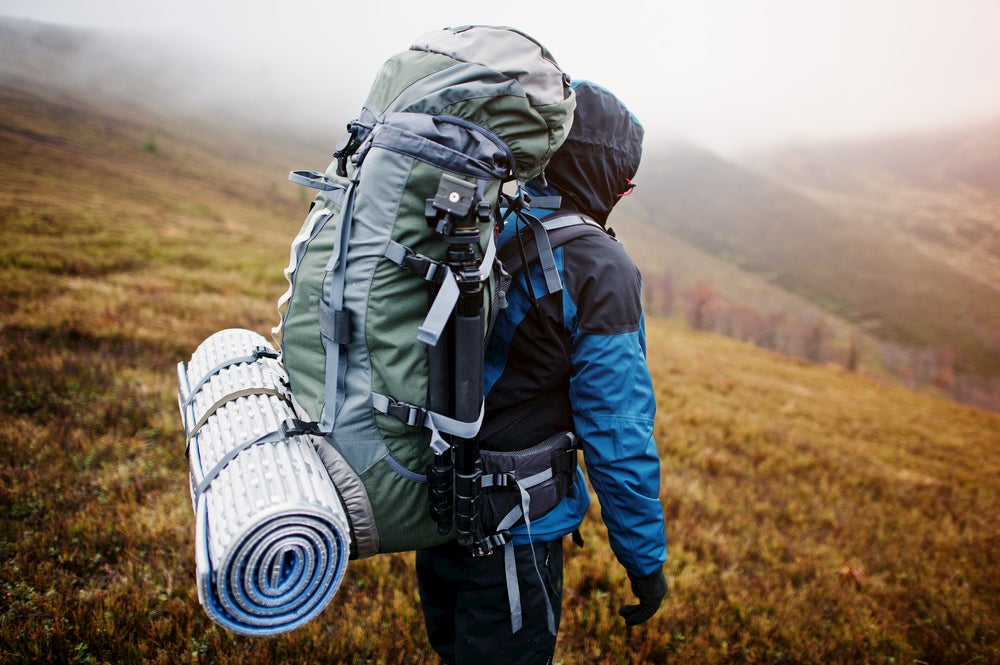 Backpacker carrying fairly large pack in the backcountry.