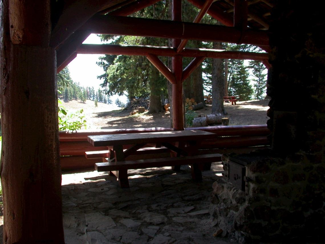 Picnic table and stone structure at Godman Campground.