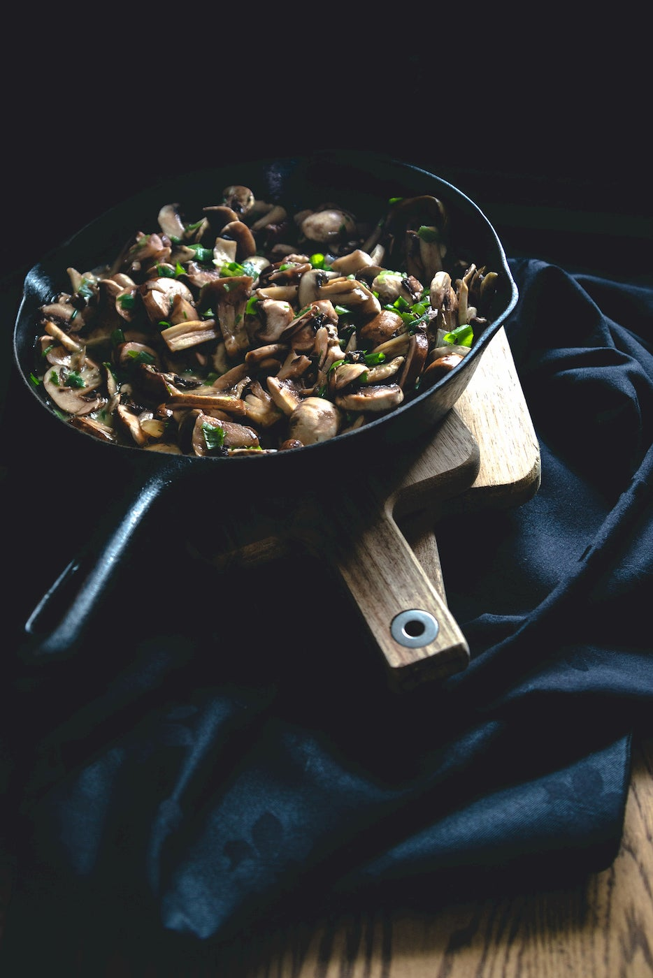 Sauteed mushrooms with herbs in a cast iron.
