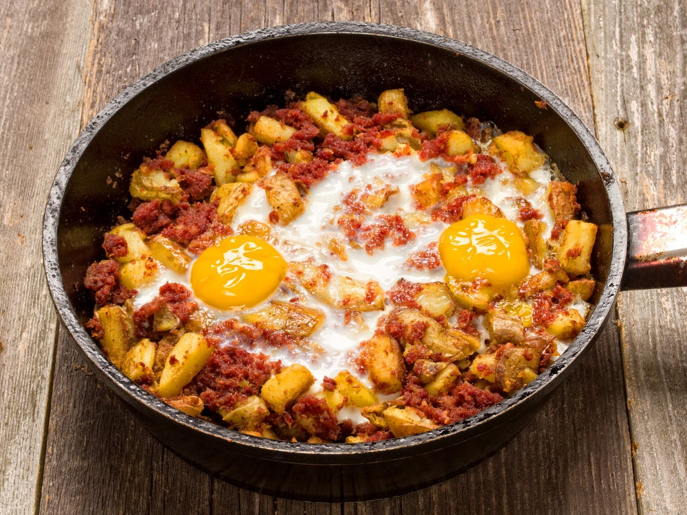 a pan of corned beef hash and eggs
