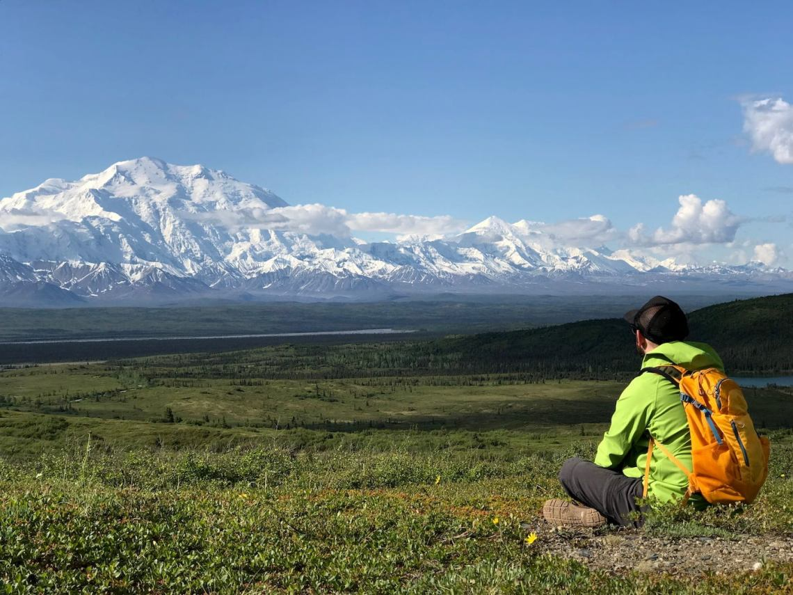 Hiker sitting in the Denali backcountry.