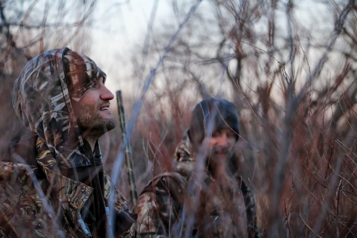 Hunters dressed in camouflage.