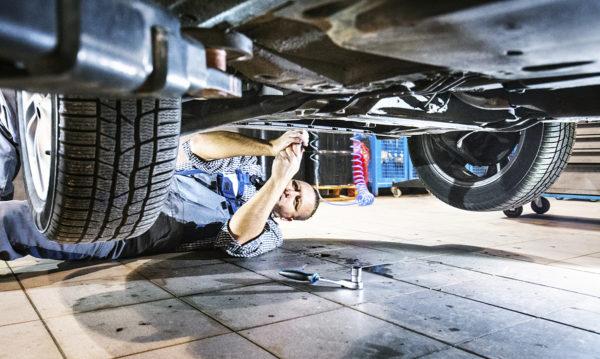 mechanic underneath car for repair