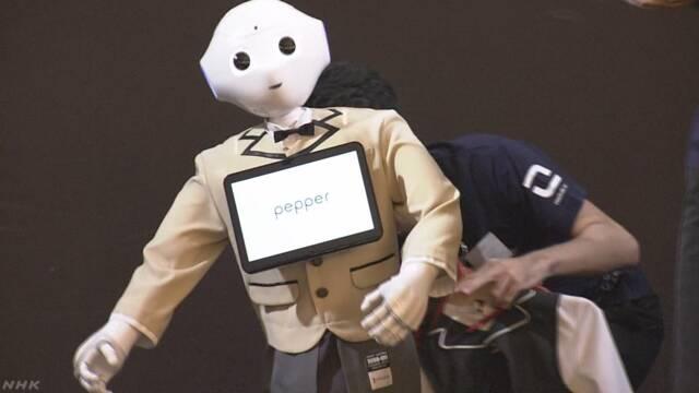 ロボットのファッションショー タキシードや白衣も | NHKニュース