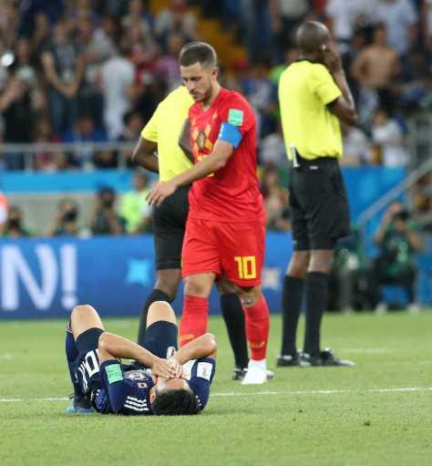 <ベルギー・日本>試合終了後、ピッチに倒れ込む香川(撮影・西尾 大助)
