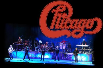 Chicago the band on stage with their logo