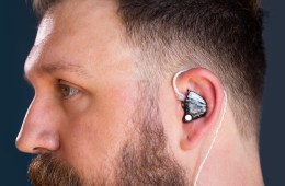 Close up of James Mead wearing 64 Audio in-ear monitors