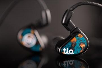 64 Audio Fourte Noir universal earphones sitting on black surface