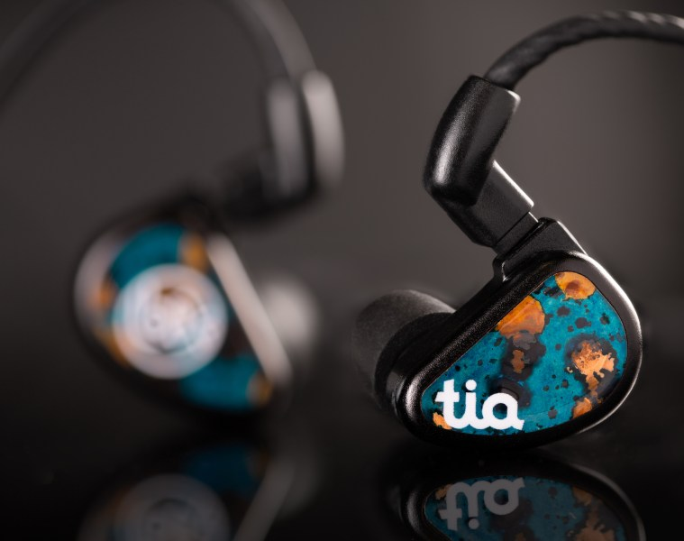 64 Audio Fourte Noir universal earphones sitting on black surface