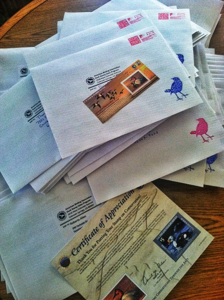 A pile of Ducks Stamps at the ABA Office, ready for distribution to those who purchased through the ABA.