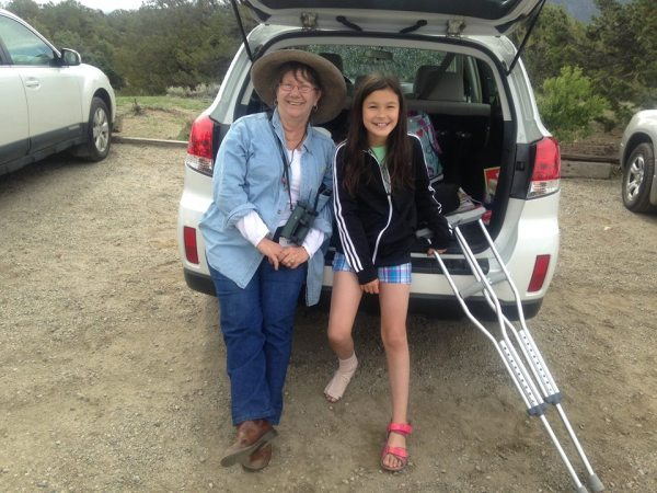 Cool birders Catherine Waters (left, corrective lenses) and Hannah Floyd (right, crutches). Big Sandy Draw, Chaffee County; Colorado; June 4, 2015.