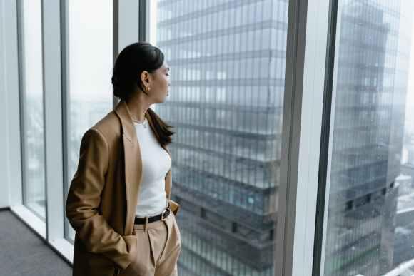 a woman looking outside a glass window