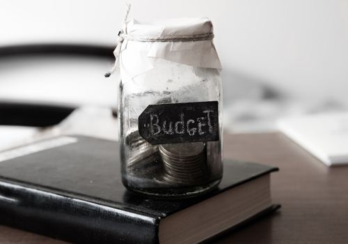 Budgeting: glass bank with coins