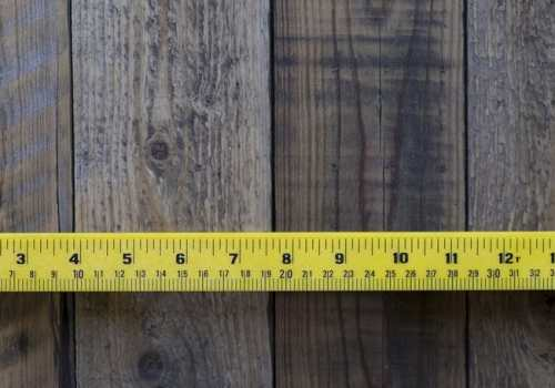 ruler on wood table background, top view