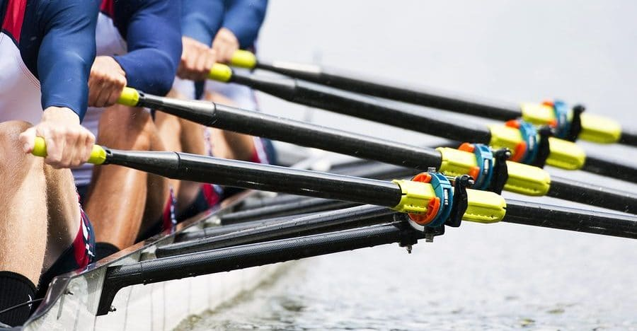 Close up of a men's quadruple skulls rowing team, seconds after