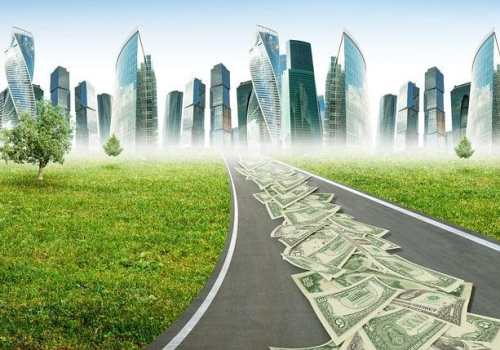Highway road with money leading to city