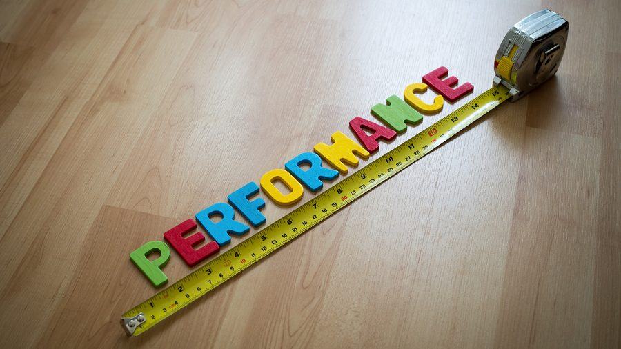 "Word spelling ""Performance"" and yellow measuring tape on wooden floor background. Performance measurement concept. (selective focus)--corporate performance management (CPM)Word spelling ""Performance"" and yellow measuring tape on wooden floor background. Performance measurement concept. (selective focus)--driver based planning"