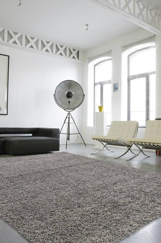How To Use Area Rugs Cover Boring