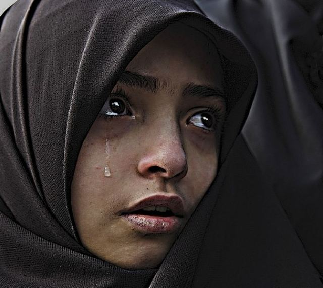 Muslima in tears.