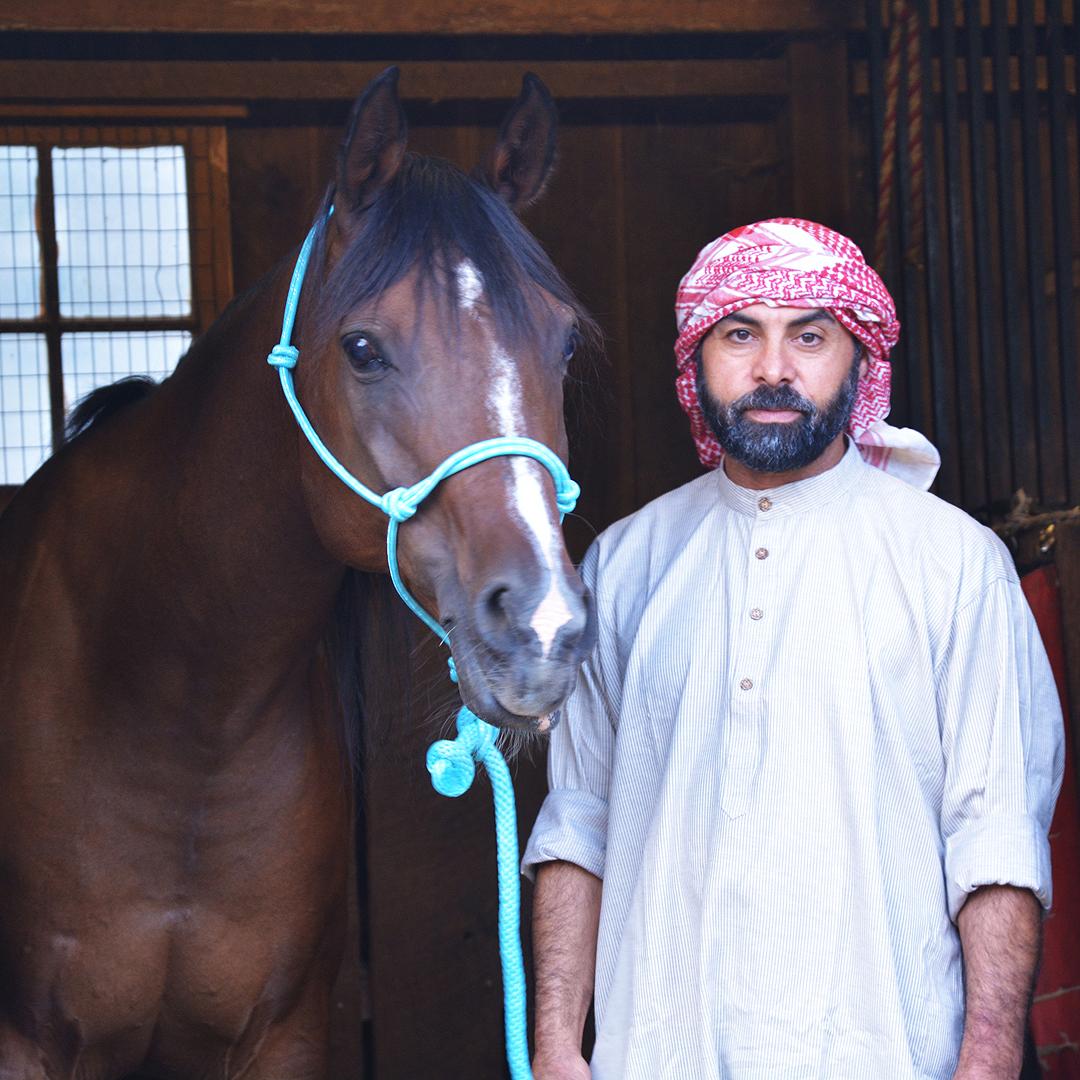 Ahmed & Arabian Horse Waleed Standing Together