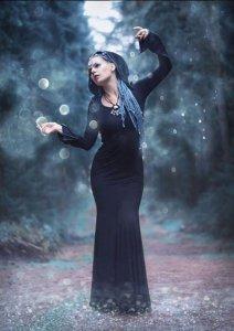 FEMININE ENERGY: Mai poses in the forest.