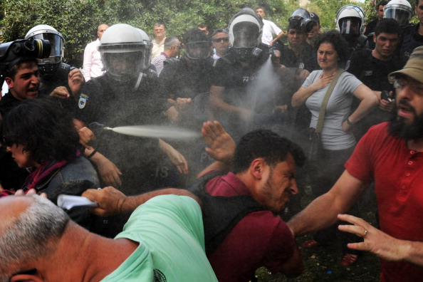Police reportedly used tear gas on May 28 to disperse a group protesting the demolition of Taksim Gezi Park in Istanbul. This was just one of many recent instances where Turkish police have used excessive force to repress peaceful protests (Photo Credit: Bulent Kilic/AFP/Getty Images).